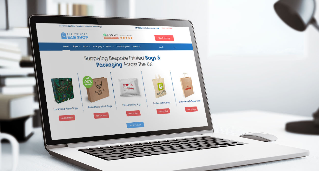 The Printed Bag Shop on laptop