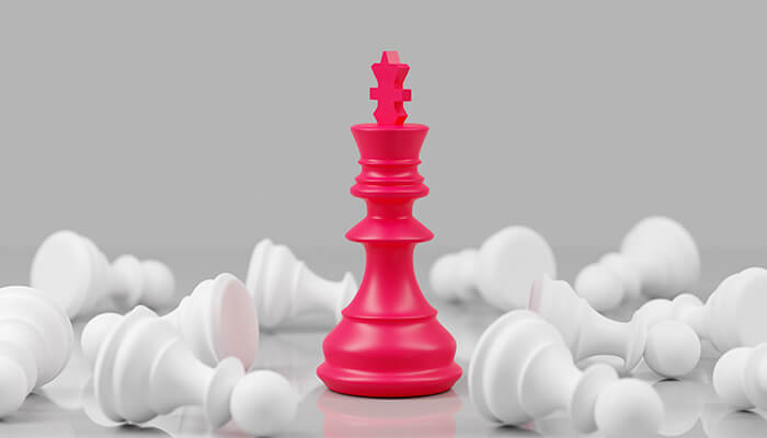 chess pieces red knocking down white